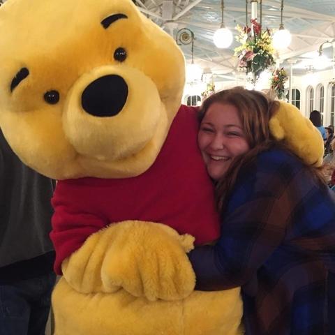 Staff Member Sydney hugging Winnie the Pooh